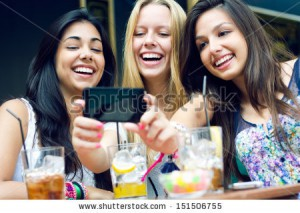 stock-photo-outdoor-portrait-of-three-friends-taking-photos-with-a-smartphone-151506755